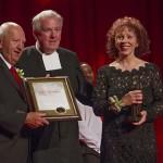 Bro. William Mann (Saint Mary's President) presents Heritage Award to Mike and Joette Gostomski.