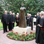 Brothers take a look at the new statue.