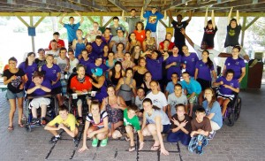 Campers invite physically and intellectually handicapped kids to participate in a day camp