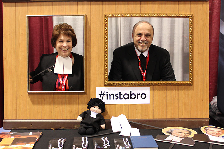 Dr. Maggie McCarty and Bro. Bob Schieler have fun in the photo booth