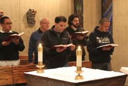 (L-R) Brothers Dan Monroe, Stephen Markham, David Deradoorian, Joseph Wright, and Patrick Martin praying