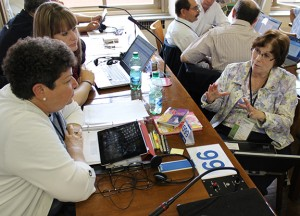 At the International Mission Assembly in 2013, McCarty speaks with fellow RELAN delegates Janet Ruggiero and Heather Ruple.