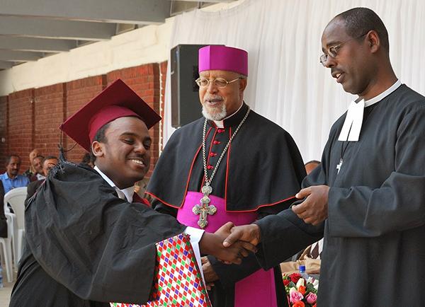 Berhaneyesus Demerew Souraphiel (center) at St. Joseph School.